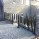 black metal railings on staircase leading to house garage front view